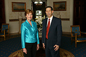 Laura Bush, Honorary Ambassador for the Decade of Literacy poses with with UNESCOís Assistant Director General for Culture Mounir Bouchenaki in the Blue Room of the White House, Wednesday, May 12, 2004.<br /> Mandatory Credit: Tina Hager / White House via CNP