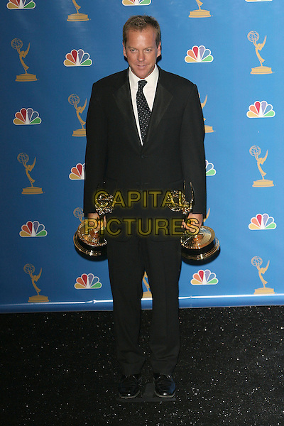 KIEFER SUTHERLAND.Press Room - 58th Annual Primetime Emmy Awards held at the Shrine Auditorium, Los Angeles, California, USA, .27 August 2006..emmys full length holding award trophies suit tie keifer.Ref: ADM/ZL.www.capitalpictures.com.sales@capitalpictures.com.©Zach Lipp/AdMedia/Capital Pictures.