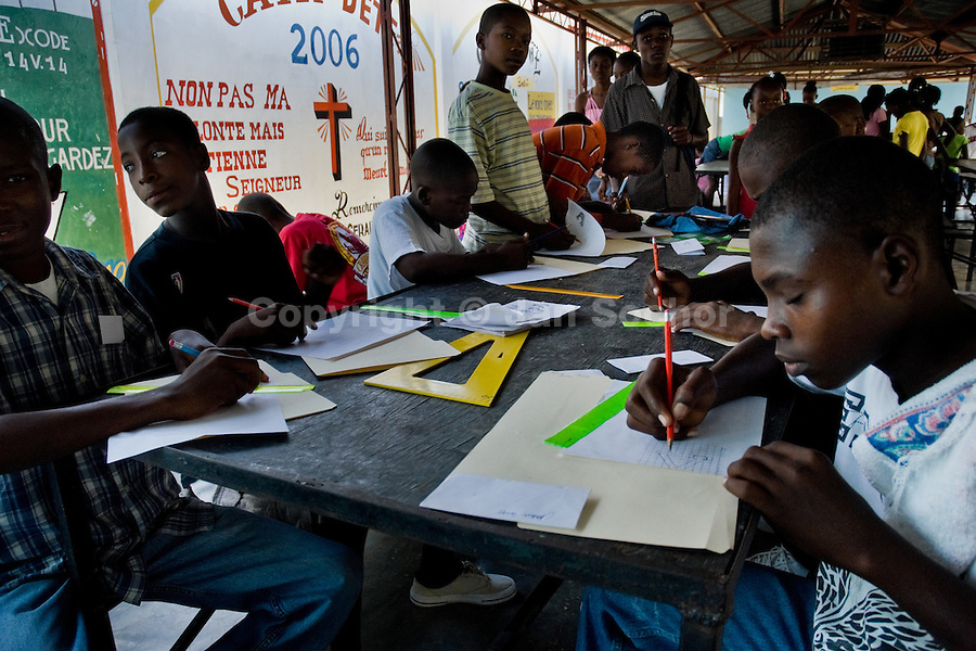 Haitian kids having classes in Saint Claire, the education and feeding center run by a Christian organization in Port-au-Prince, Haiti, July 8, 2008.