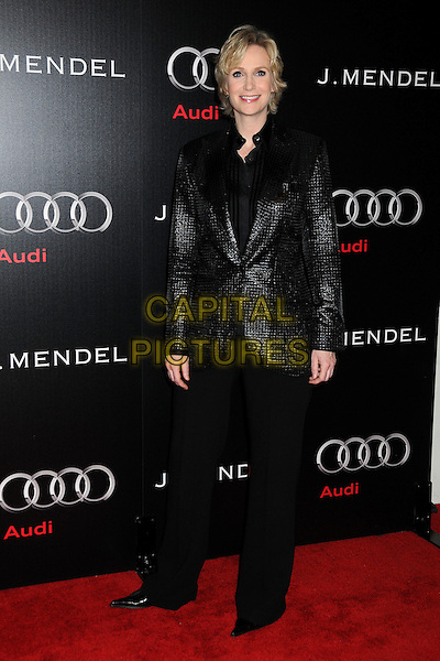JANE LYNCH .Audi and J. Mendel Celebrate the 2011 Golden Globe Awards held at Cecconi's, Los Angeles, California, USA, .9th January 201..full length jacket trousers suit  shiny black shirt .CAP/ADM/BP.©Byron Purvis/AdMedia/Capital Pictures.