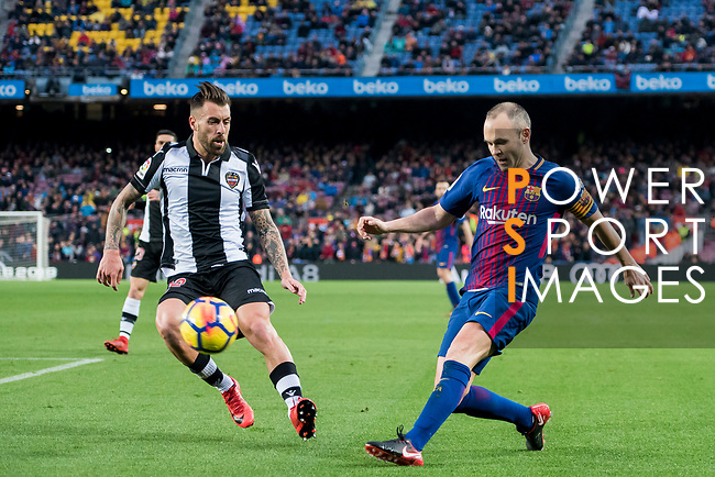 Andres Iniesta Lujan of FC Barcelona competes for the ball with Antonio Manuel Luna Rodriguez of Levante UD during the La Liga 2017-18 match between FC Barcelona and Levante UD at Camp Nou on 07 January 2018 in Barcelona, Spain. Photo by Vicens Gimenez / Power Sport Images