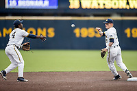 Michigan Wolverines shortstop Jack Blomgren (18) waits for the ball tossed from teammate Ako Thomas (4) against the Maryland Terrapins on April 13, 2018 in a Big Ten NCAA baseball game at Ray Fisher Stadium in Ann Arbor, Michigan. Michigan defeated Maryland 10-4. (Andrew Woolley/Four Seam Images)