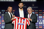 Atletico de Madrid's new player Felipe Monteiro (c) with the General Manager Andrea Berta (l) and the President Enrique Cerezo during his official presentation. July 4, 2019. (ALTERPHOTOS/Acero)