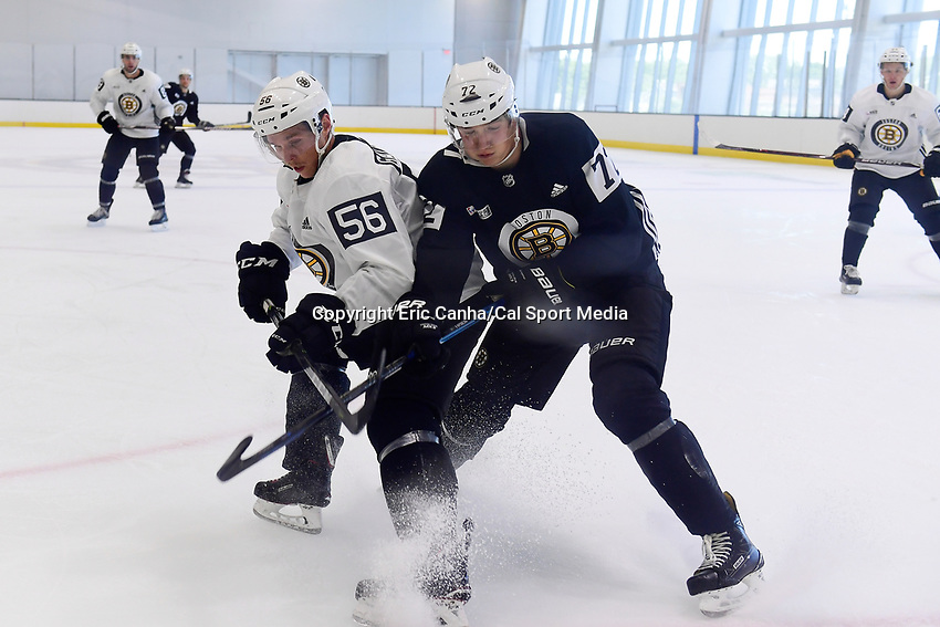 June 29, 2018: Boston Bruins defenseman Olivier Galipeau (56) and forward Jack Becker (72) battle for the puck during a scrimmage at the Boston Bruins development camp held at Warrior Ice Arena in Brighton Mass. Eric Canha/CSM