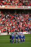 Barnsley 0 Huddersfield Town 1, 12/05/2006. Oakwell, League One Play Off Semi Final 1st Leg. Barnsley (red shirts) versus Huddersfield Town, Coca-Cola League One play-off semi-final first leg at Oakwell, Barnsley. The visitors won one-nil with a goal from Gary Taylor-Fletcher in 85 minutes. Picture shows Town players getting into their pre-match huddle in front of the Barnsley supporters. Photo by Colin McPherson.
