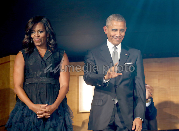 """US President Barack Obama and First Lady Michelle Obama attend a performance at the Kennedy Center called """"Taking the Stage; African American Music and Stories that Changed America,""""  an event celebrating the opening of the Smithsonian National Museum of African American History and Culture, September 23, 2016, Washington, DC. Photo Credit: Aude Guerrucci/CNP/AdMedia"""