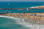 Crowded beach full of people in Summer at Corona del Mar, Newport Beach, Orange County, California