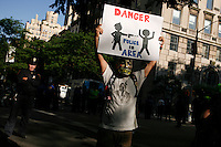 "A Occupy wall street member takes part during a silent march to end the ""stop-and-frisk"" program in New York June 17, 2012.  Photo by Kena Betancur / VIEWpress.."