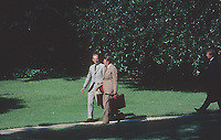 Washington DC., USA, September 1,  1984<br /> President Ronald Reagan and Chief of Staff James Baker III walk from the Oval Office to Marine One on the South Lawn. Credit: Mark Reinstein/MediaPunch