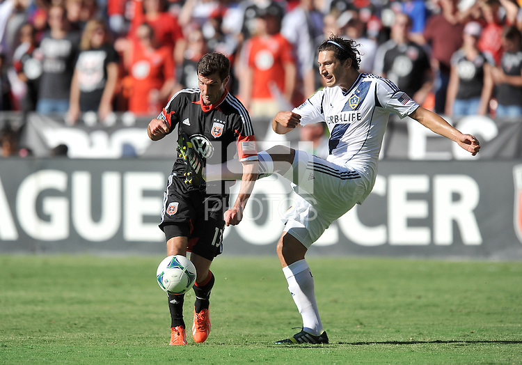 Chris Pontius (13) of D.C. United goes against Omar Gonzalez (4) of the Los Angeles Galaxy.  D.C. United tied the Los Angeles Galaxy 2-2, at RFK Stadium, Saturday September 14 , 2013.