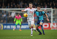James Collins of Crawley Town holds off Max Muller of Wycombe Wanderers during the Sky Bet League 2 match between Wycombe Wanderers and Crawley Town at Adams Park, High Wycombe, England on 25 February 2017. Photo by Andy Rowland / PRiME Media Images.
