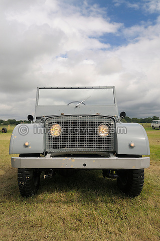 Land Rover Centre Steer replica of the original Jeep/Rover prototype from 1947 which became the Land Rover. Dunsfold Collection of Land Rovers Open Day 2011, Dunsfold, Surrey, UK. --- No releases available, but releases may not be necessary for certain uses. Automotive trademarks are the property of the trademark holder, authorization may be needed for some uses. --- Vehicle Information: Vehicle belongs to the Dunsfold Collection of Land Rovers: Engine Rover car 1.5 ltr 4-cyl petrol, Gearbox 4-speed. --- Vehicle History: This is a replica of the original Jeep / Rover prototype from 1947. The running gear was Jeep with a Rover main gearbox and engine. It has been built from photos to a very exacting scale. The original was broken up when the first pre productions were being trailed so does not exist, contrary to many rumours. There were at least 2 stages of the Centre Steer with changes for tyres, chassis, axle paint colours, winch mock up and many minor changes. This replica was built to represent the last stage of development. It is a very good copy of what the original model would have looked like.