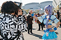 A photographer takes pictures of a cosplayer during the Comic Market 91 (Comiket) event in Tokyo Big Sight on December 31, 2016, Tokyo, Japan. Manga and anime fans arrived in the early morning hours on the opening day of the 3-day long event. Held twice a year in August and December, the Comiket has been promoting manga, anime, game and cosplay culture since its establishment in 1975. (Photo by Rodrigo Reyes Marin/AFLO)