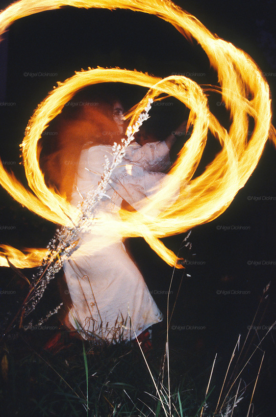 A woman dances with fire at night at a Road Protest action at Twyford Down, near the Donga pathways, outside Winchester, against the M3 road extension. 1992-94<br />