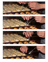 One of the magical things about watching a good chef make takoyaki is how quickly and elegantly their hands move.  To form the takoyaki the batter is first cooked somewhat on the pan, and then the half-cooked batter is delicately (and quickly) rolled into a ball using chopsticks.  There are eight images total in this sequence (the other four should be before or after this one in the gallery); compare all the images of this sequence to see the process.  The last 7 of these frames were shot over only two seconds.<br /> <br /> Chef Ryota Akai of Japan forms takoyaki during a demonstration of takoyaki cooking at Mitsuwa Market in Costa Mesa, California.