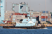 Tugboat Sarah Ann passes the A.P. Moller-Maersk facility in the Port Newark-Elizabeth Marine Terminal in Newark Bay.