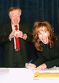 Paula Jones signs the agreement with Abe Hirschfeld (L) conditionally accepting his million dollar offer to settle her sexual harassment  lawsuit against United States President Bill Clinton at the Mayflower Hotel in Washington, DC on 31 October, 1998.<br /> Credit: Ron Sachs / CNP
