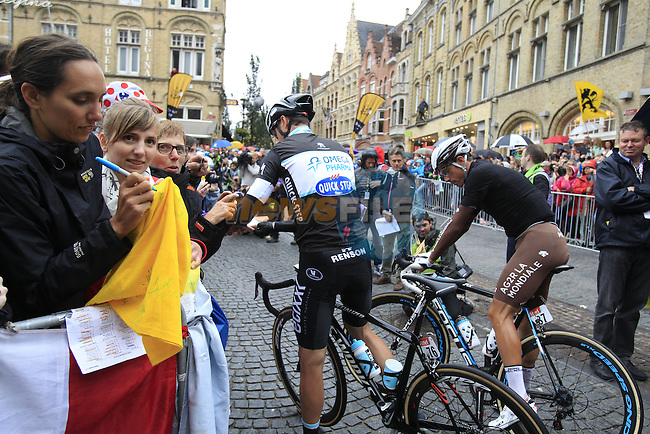 Alessandro Petacchi (ITA) Omega Pharma-Quick Step and Sebastien Minard (FRA) AG2R La Mondiale at sign on in Ypres before the start of the cobbled stage Stage 5 of the 2014 Tour de France running 155.5km from Ypres to Arenberg. 9th July 2014.<br /> Picture: Eoin Clarke www.newsfile.ie