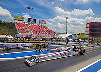 Jun 21, 2015; Bristol, TN, USA; NHRA top fuel driver Richie Crampton (near) races alongside Shawn Langdon during the Thunder Valley Nationals at Bristol Dragway. Mandatory Credit: Mark J. Rebilas-USA TODAY Sports