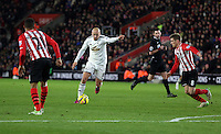 Pictured: Jonjo Shelvey of Swansea (C) scoring his goal Sunday 01 February 2015<br />