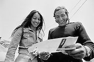 "07 Jul 1972, Newport, Newport County Borough, Wales, UK. French navigator Alain Colas, and his fiancée Teura, reading congratulation telegrams upon winning the Transat Plymouth-Newport race. He won the race on the trimaran Pen Duick IV, which was previously owned by Eric Tabarly. He will rename it Manureva. Colas would disappear in the Atlantic in November 1978 whilst competing in the first ""Route du Rhum"" race. Image by © JP Laffont"