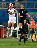Shannon Boxx, Amber Hearn. The USWNT defeated New Zealand, 4-0, during the 2008 Beijing Olympics in Shenyang, China.  With the win, the USWNT won group G and advanced to the semifinals.