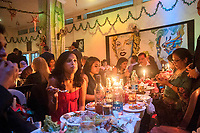 Members enjoying candle lit dinner at Grail Club. Grail club is an exclusive Anglo Indian club in Kolkata.