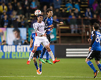Santa Clara, California -Saturday, March 29, 2014: Daigo Kobayashi of NE Revolution and Chris Wondolowski of SJ Earthquakes jump for the ball during a match at Buck Shaw Stadium. Final Score: SJ Earthquakes 1, NE Revolution 2