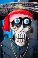 Skeletal pirate mascot in front of a store in St. Thomas.