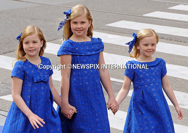 "30.04.2013; Amsterdam: KING WILLEM-ALEXANDER INAUGURATION.PRINCESS ALEXIA(left), PRINCESS CATHARINA-AMALIA AND PRINCESS ARIANE(right) OF THE NETHERLANDS.Princess Alexia (left) Crown Princess Catharina-Amalia, and Princess Ariane (right).attend their father King Willem-Alexander's inauguration at Nieuwe Kerk, Amsterdam, The Netherlands, .Mandatory Credit Photos: ©NEWSPIX INTERNATIONAL..**ALL FEES PAYABLE TO: ""NEWSPIX INTERNATIONAL""**..PHOTO CREDIT MANDATORY!!: NEWSPIX INTERNATIONAL(Failure to credit will incur a surcharge of 100% of reproduction fees)..IMMEDIATE CONFIRMATION OF USAGE REQUIRED:.Newspix International, 31 Chinnery Hill, Bishop's Stortford, ENGLAND CM23 3PS.Tel:+441279 324672  ; Fax: +441279656877.Mobile:  0777568 1153.e-mail: info@newspixinternational.co.uk"