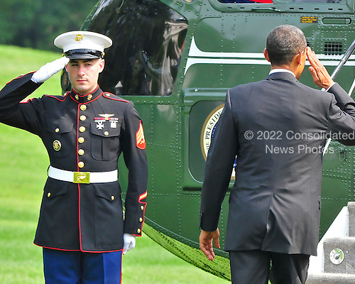 United States President Barack Obama salutes the Marine Guard as he boards Marine One to depart the White House en route to Chicago, Illinois on Wednesday, August 4, 2010.  The President will celebrate his 49th birthday with close friends in Chicago..Credit: Ron Sachs / CNP.(RESTRICTION: NO New York or New Jersey Newspapers or newspapers within a 75 mile radius of New York City)