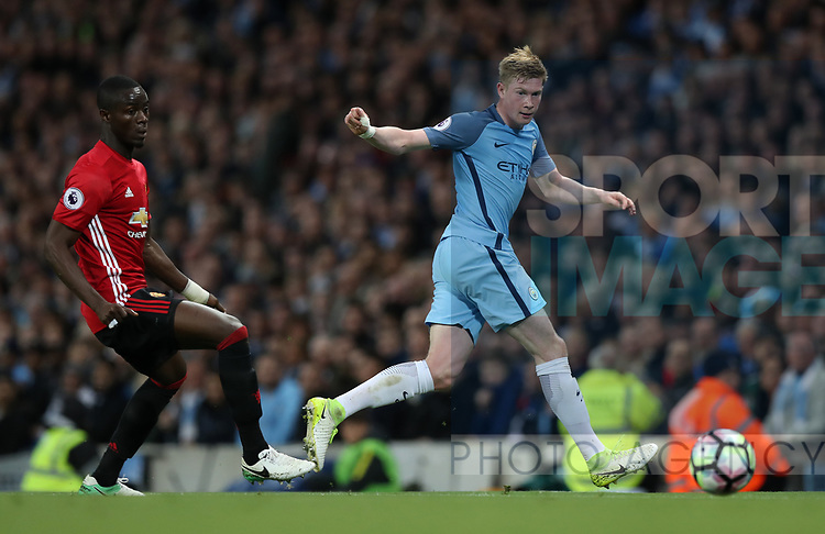 Eric Bailly of Manchester United and Kevin De Bruyne of Manchester City during the English Premier League match at The Etihad Stadium, Manchester. Picture date: April 27th, 2016. Photo credit should read: Lynne Cameron/Sportimage