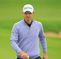 Justin Rose (ENG) on the 4th green during Saturay's Round 3 of the 2014 BMW Masters held at Lake Malaren, Shanghai, China. 1st November 2014.<br /> Picture: Eoin Clarke www.golffile.ie