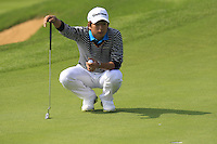 Kim Seung-hyuk (KOR) on the 9th green during Sunday's Final Round of the 2014 BMW Masters held at Lake Malaren, Shanghai, China. 2nd November 2014.<br /> Picture: Eoin Clarke www.golffile.ie