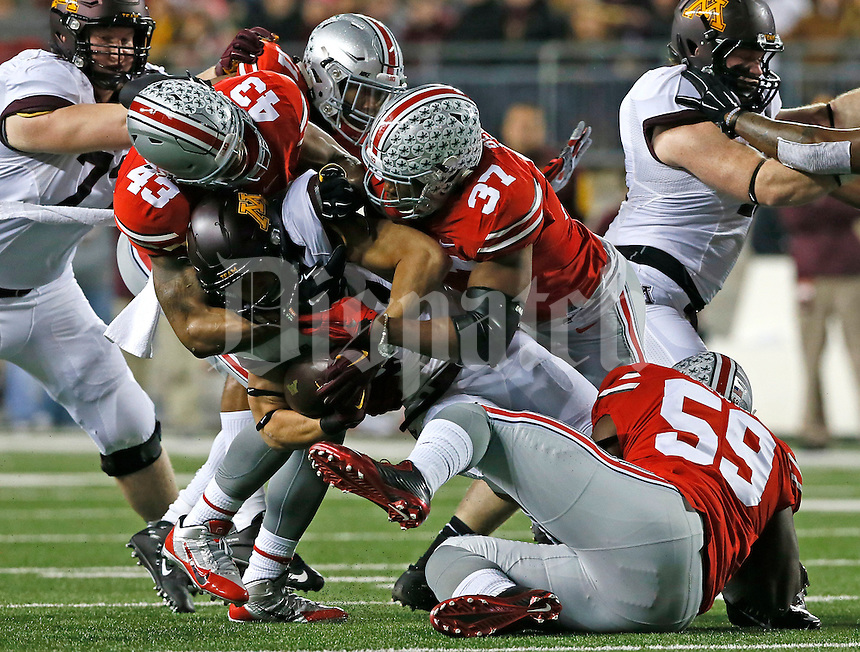 Minnesota Golden Gophers running back James Johannesson (27) is tackled by Ohio State Buckeyes linebacker Joshua Perry (37) and Ohio State Buckeyes linebacker Darron Lee (43) in the first half of their game at Ohio Stadium in Columbus, Ohio on November 7, 2015. (Columbus Dispatch photo by Brooke LaValley)