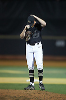 Wake Forest Demon Deacons relief pitcher Chris Farish (32) adjust his cap during the game against the Virginia Cavaliers at David F. Couch Ballpark on May 18, 2018 in  Winston-Salem, North Carolina.  The Cavaliers defeated the Demon Deacons 15-3.  (Brian Westerholt/Four Seam Images)