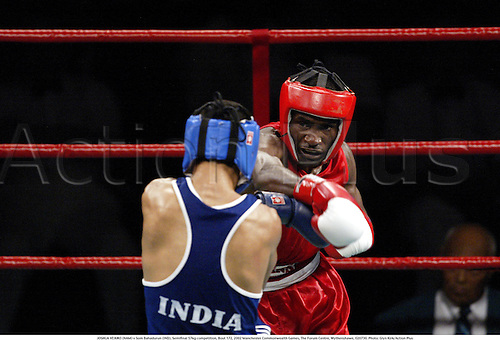 JOSHUA VEIKKO (NAM) v Som Bahadurun (IND), Semifinal 57kg competition, Bout 172, 2002 Manchester Commonwealth Games, The Forum Centre, Wythenshawe, 020730. Photo: Glyn Kirk/Action Plus...Boxer boxers boxing.combat sport sports..........