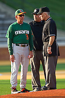 "Miami Hurricanes head coach Jim Morris #3 meets with umpires prior to the game against the Wake Forest Demon Deacons at Gene Hooks Field on March 18, 2011 in Winston-Salem, North Carolina.  Morris felt that the mound was too high, but it was found to be the regulation 10"" above home plate.  Photo by Brian Westerholt / Four Seam Images"