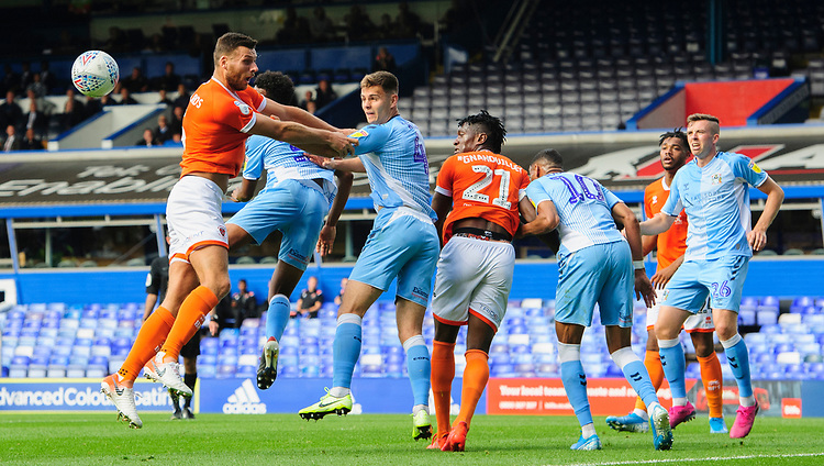 Coventry City's Michael Rose heads clear under pressure from Blackpool's Ryan Edwards<br /> <br /> Photographer Chris Vaughan/CameraSport<br /> <br /> The EFL Sky Bet League One - Coventry City v Blackpool - Saturday 7th September 2019 - St Andrew's - Birmingham<br /> <br /> World Copyright © 2019 CameraSport. All rights reserved. 43 Linden Ave. Countesthorpe. Leicester. England. LE8 5PG - Tel: +44 (0) 116 277 4147 - admin@camerasport.com - www.camerasport.com