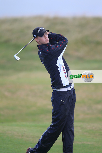 Ryan McKinstry (Cairndhu) on the 14th fairway during the South of Ireland Amateur Open Championship Third Round at Lahinch Golf Club  29th July 2013 <br /> Picture:  Thos Caffrey / www.golffile.ie