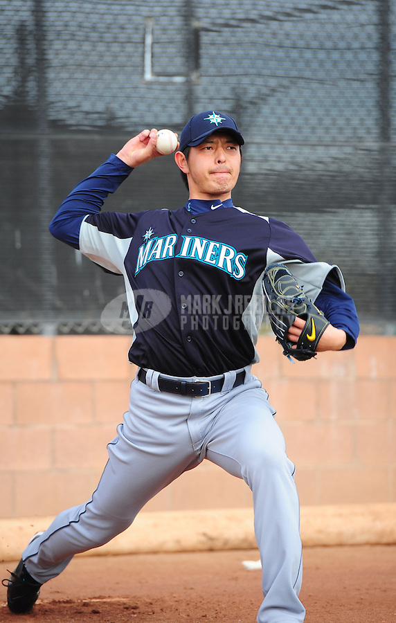 Feb. 15, 2012; Peoria, AZ, USA; Seattle Mariners pitcher Hisashi Iwakuma throws during a pitchers and catchers workout at the Peoria Sports Complex.  Mandatory Credit: Mark J. Rebilas-.