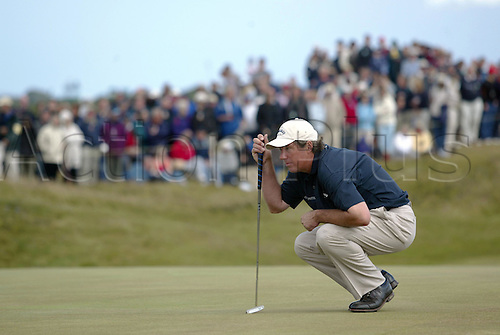 18 July 2004:  English golfer BARRY LANE (ENG) lines up his putt on the 13th green during the final round of The Open Championship, Royal Troon, Scotland. Photo: Glyn Kirk/Action Plus....golf golfers 040718 putting putts putter