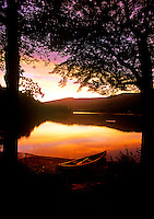 Canoe by the edge of a lake, ME, Maine,