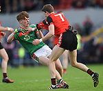 Dermot Coughlan of Kilmurry Ibrickane and Brian Carrig of Clondegad get tied together during their senior county final at Cusack park. Photograph by John Kelly.