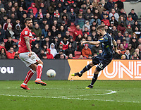 Leeds United's Mateusz Klich (right) crosses the ball despite the attentions of Bristol City's Marlon Pack (left) <br /> <br /> Photographer David Horton/CameraSport<br /> <br /> The EFL Sky Bet Championship - Bristol City v Leeds United - Saturday 9th March 2019 - Ashton Gate Stadium - Bristol<br /> <br /> World Copyright © 2019 CameraSport. All rights reserved. 43 Linden Ave. Countesthorpe. Leicester. England. LE8 5PG - Tel: +44 (0) 116 277 4147 - admin@camerasport.com - www.camerasport.com