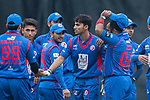 Shahid Wasif of Kowloon Cantons (C) celebrates with his team during the Hong Kong T20 Blitz match between Kowloon Cantons and City Kaitak at Tin Kwong Road Recreation Ground, Hong Kong, China. Photo by Chris Wong / Power Sport Images