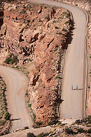 Cyclists climb the 1000-foot Mokee Dugway pass up Cedar Mesa near Mexiacn Hat, Utah, July 1, 2010. The road, cut by uranium miners a half century ago, was the ispiration for Edward Abbey's Monkey Wrench Gang. The Red Rock Canyons Tour, organized by Lizard Head Cycling Tours, wound through 400 miles of the desert southwest. The route traveled through canyons and national monuments in Colorado, Utah and Arizona, ending at Lake Powell. (Kevin Moloney for the New York Times)