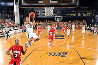 28 January 2012:  FIU guard Cameron Bell (10) puts up a basket over WKU guard Kahlil McDonald (3) in the second half as the Western Kentucky University Hilltoppers defeated the FIU Golden Panthers, 61-51, at the U.S. Century Bank Arena in Miami, Florida.