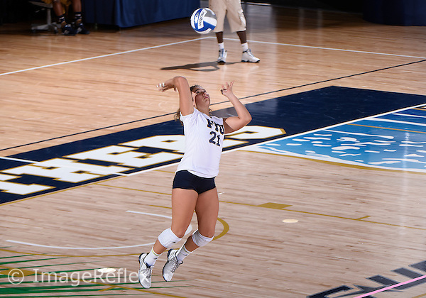 Florida International University women's volleyball setter Dominique Dodd (21) plays against  the University of Central Florida which won the match 3-0 on September 17, 2015 at Miami, Florida.