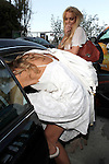"June 12th 2010..Lindsay Lohan leaving a Hollywood Hills party with her sister Ali &  Lady Victoria Lindsay was drinking a Hangover energy drink. Lindsay seemed pretty happy & was smiling & posing while showing off her new red purse. Ali was carrying a Vogue beach bag & wearing bell bottoms. Lindsay was checking out Lady Victoria's butt as she got into the car.  As Lindsay left the pool party a photographer asked, ""Hey Lindsay did you go swimming?"" Lindsay replied, ""Ha ha you know I can't swim with a SCRAM bracelet on!"" ...AbilityFilms@yahoo.com.805-427-3519.www.AbilityFilms.com"
